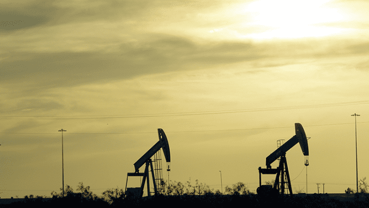 king permian oil pump jacks against a golden sunset