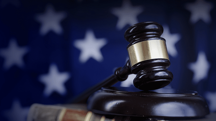 Energy at the Forefront of Federal Policy Agenda Gavel on American Flag Background