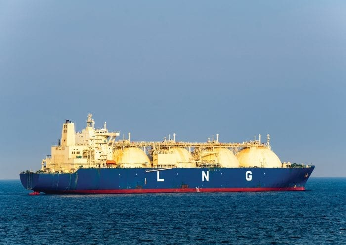 Large liquefied natural gas (LNG) carrier with 4 LNG tanks sails along the sea