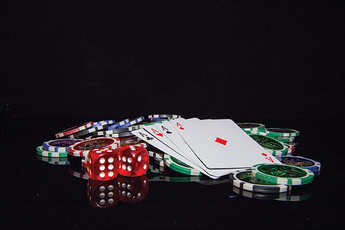 Multicolored chips for playing in a casino - Oilfield Helping Hands Poker Night Fundraiser