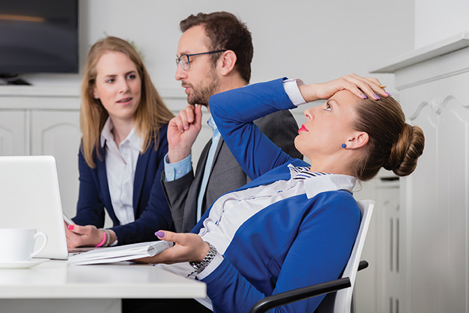 bigstock--129678386 - Young female professional employee doesn't agree with the opinion of her colleagues on a business meeting