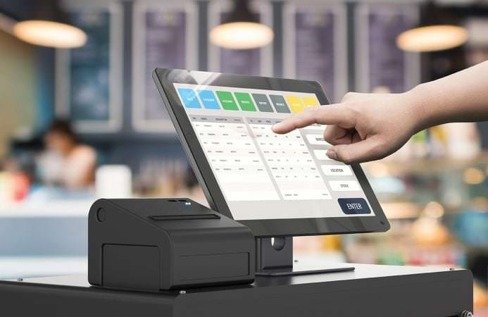 human hand working with cashier machine in bakery shop