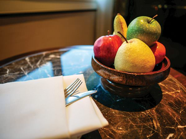 bigstock--182410195 - Pear green apple red apple banana and orange served on wooden bowl as a hotel complimentary.