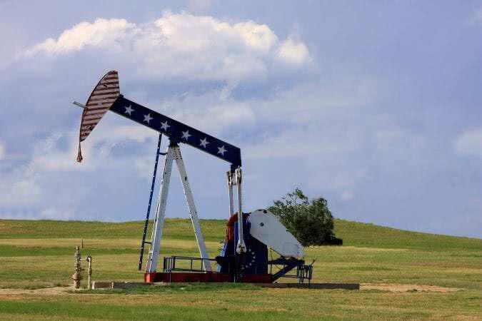 Patriotic Oil Rig - Oil Pump Jack with American Flag painted on it