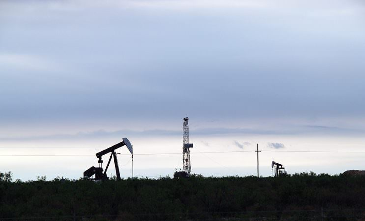 Midland TX (5/4/09) - Sunrise in the Permian Basin see pump jacks along with a new well being drilled in west Texas. Energy Minute In The Oil Patch