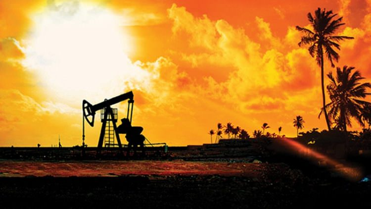 Panorama image of working oil pump silhouette against sunset